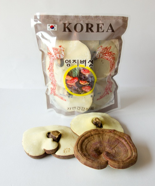 Korean red lingzhi in brown bag